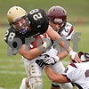 Beck Diefenbach  -  bdiefenbach@daily-chronicle.com<br /> <br /> Sycamore running back Joe Dougherty (28, left) is taken down by Montini defensive back Nick Campanella (24, center) and linebacker Doug Diedrick (34) during the first quarter of the playoff game at Sycamore High School in Sycamore, Ill., on Saturday Nov. 14, 2009.