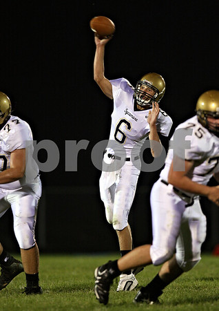Beck Diefenbach  -  bdiefenbach@daily-chronicle.com<br /> <br /> Sycamore quarterback Ryan Bartels (6) throws the ball during the first quarter of the game against Burlington Central High School at Burlington Central High School in Hampshire, Ill., on Friday Sept. 4, 2009.