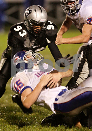 Beck Diefenbach  -  bdiefenbach@daily-chronicle.com<br /> <br /> Kaneland's Alex Barron (93, top) leaps to tackle Glendbard South's Joe Moore (45) during the second quarter of the game at Kaneland High School in Maple Park, Ill., on Friday Oct. 2, 2009