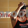 Beck Diefenbach  -  bdiefenbach@daily-chronicle.com<br /> <br /> Casey Jepsen dons her swim cap before getting into the water for practice at DeKalb High School in DeKalb, Ill., on Thursday Nov. 19, 2009.