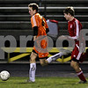 Rob Winner – rwinner@daily-chronicle.com<br /> In the first half, DeKalb's Chris Calbow moves the ball down field as Marian's Nick Pierce chases during the IHSA Class 2A Freeport Sectional semifinal in Belvidere on Tuesday October 27, 2009. DeKalb defeated Marian, 1-0.