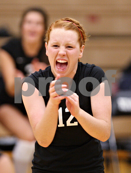 Beck Diefenbach – bdiefenbach@daily-chronicle.com<br /> <br /> Kaneland's Taylor Bradbury (12) celebrates following a point during the third period of the game against DeKalb High School at Kaneland High School in Maple Park, Ill., on Saturday Sept. 19, 2009.