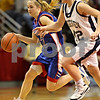 Beck Diefenbach – bdiefenbach@daily-chronicle.com<br /> <br /> Hinckley-Big Rock guard Maxzine Rossler (22) dribbles past Ridgeview forward Lacey Gleeson (42) during the fourth quarter of the Class 1A Girls Basketball Semi-Final game at the Red Bird Arena in Normal, Ill., on Friday Feb. 27, 2009.