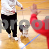 Beck Diefenbach  -  bdiefenbach@daily-chronicle.com<br /> <br /> Dog trainer Marcia Poff, right, gestures to Pandi, a Corgi, as the owner Colleen Melmont, of DeKalb, walks with the dog during a showmanship class at the Haish Gym in DeKalb, Ill., on Thursday March 26, 2009.