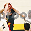 Beck Diefenbach  -  bdiefenbach@daily-chronicle.com<br /> <br /> Batavia forward Ricky Clopton (22) (center) is blocked by Sycamore's John Dwyer (2), left and Shane Carnahan (33), right, during the first quarter of the game at Sycamore High School on in Sycamore, Ill., on Tuesday Jan. 6, 2009.