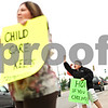 Beck Diefenbach  -  bdiefenbach@daily-chronicle.com<br /> <br /> Christian Killen, 10, rallies for honks from motorists in support of the many child care providers and other social services demonstrating at the office of Illinois State Representative Robert Pritchard in Sycamore, Ill., on Thursday June 11, 2009.