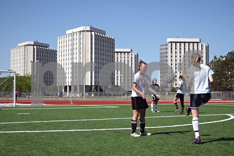 Beck Diefenbach  -  bdiefenbach@daily-chronicle.com<br /> <br /> Sycamore's Sarah Pappini (second from right) and Jenna Johnson (far right) warm up on Northern Illinois' soccer field in DeKalb, Ill., on Thursday June 4, 2009. The Sycamore soccer team was practicing on NIU's field to get aquatinted with a mondoTurf field like the one they will playing on at North Central College on Friday (today).