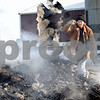 Beck Diefenbach  -  bdiefenbach@daily-chronicle.com<br /> <br /> Amy Klink, owner of JAK Ranch, tosses charred debris into the smoldering pile of remains of her horse barn which burned down Thursday on her family's ranch in Clare, Ill., on Friday Feb. 6, 2009.