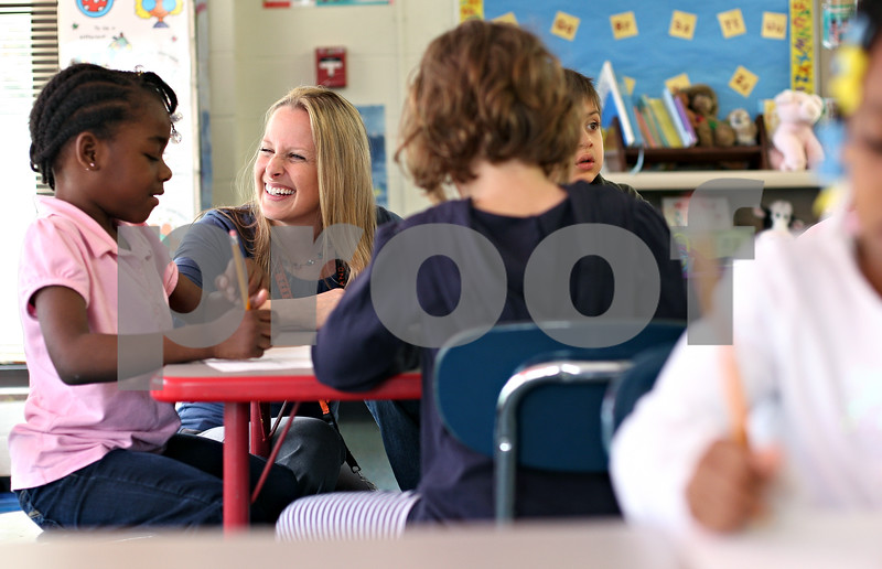 Beck Diefenbach  -  bdiefenbach@daily-chronicle.com<br /> <br /> Kindergarden teacher Susan Stensland works with Beyoncé Pitts on her journal entry during the afternoon class at Jefferson Elementary School in DeKalb, Ill., on Wednesday April 29, 2009.