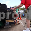 "Beck Diefenbach  -  bdiefenbach@daily-chronicle.com<br /> <br /> Northern Illinois junior Sheri Divito helps load a new student's belongings onto a golf cart to be delivered to her dormitory during ""move-in day"" at the University on Thursday Aug. 20, 2009."