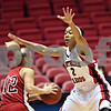 Beck Diefenbach  -  bdiefenbach@daily-chronicle.com<br /> <br /> Northern Illinois guard Shari' Welton (2) gets in the face off Ball State guard Kiley Jarrett(12) during the first half of the game at the NIU Convocation Center in DeKalb, Ill., on Wednesday Jan. 21, 2009.