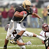 Beck Diefenbach  -  bdiefenbach@daily-chronicle.com<br /> <br /> Sycamore running back Marckie Hayes (1) slips through multiple Montini defenders during the second quarter of the playoff game at Sycamore High School in Sycamore, Ill., on Saturday Nov. 14, 2009.