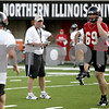 Rob Winner – rwinner@daily-chronicle.com<br /> NIU football coach Jerry Kill watches his team during practice on Thursday night.<br /> 08/06/2009