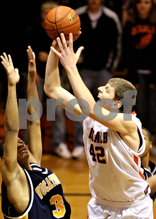 Beck Diefenbach  -  bdiefenbach@daily-chronicle.com<br /> <br /> DeKalb's Jordan Threloff (42) shoots the ball during the fourth quarter of the game against Chicago Vocational at DeKalb High School in DeKalb, Ill., on Wednesday Dec. 23, 2009.