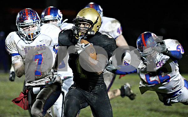 Rob Winner – rwinner@daily-chronicle.com<br /> <br /> Sycamore runningback Marckie Hayes carries the ball for a long run in the second quarter.<br /> <br /> 10/23/2009