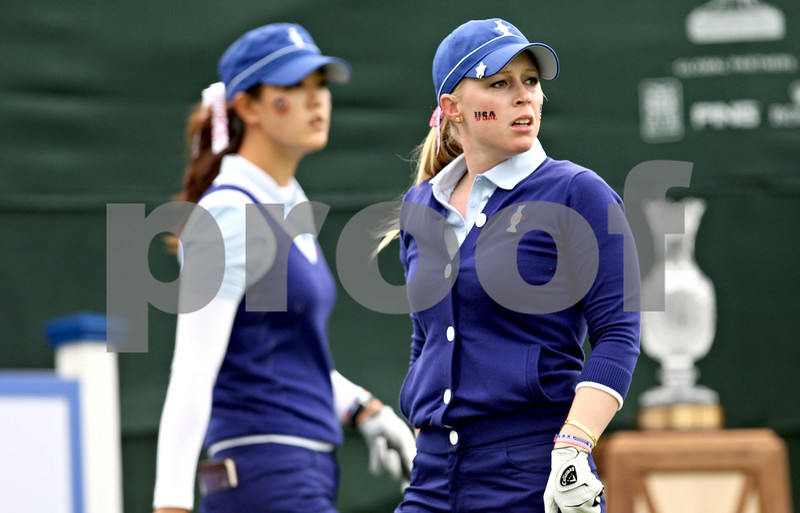 Michelle Wie (left) watches Morgan Pressel's shot from the first tee at the start of the first round of the Solheim Cup.<br /> Rob Winner rwinner@shawsuburban.com