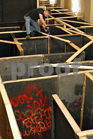 Beck Diefenbach  -  bdiefenbach@daily-chronicle.com<br /> <br /> Russell Cook, a committee member for the the Amenti Haunted House, connects walls for one of the many mazes at the Egyptian Theater in DeKalb, Ill., on Wednesday Oct. 14, 2009.