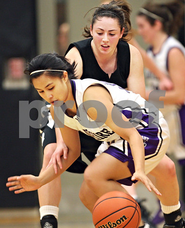 Beck Diefenbach  -  bdiefenbach@daily-chronicle.com<br /> <br /> Hampshire guard Gianina Estocado (12) attempts to recover a loose ball from the grasp of Kaneland guard Sara Rose (23) during the third quarter of the Kaneland Regional Semi Final game at Kaneland High School in Maple Park, Ill., on Tuesday Feb. 17, 2009.
