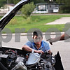 Beck Diefenbach  -  bdiefenbach@daily-chronicle.com<br /> <br /> Domingo Ortega works on replacing the headlights of his car outside of his home at Evergreen Village Mobile Home just east of Sycamore, Ill., on Thursday Sept. 3, 2009.