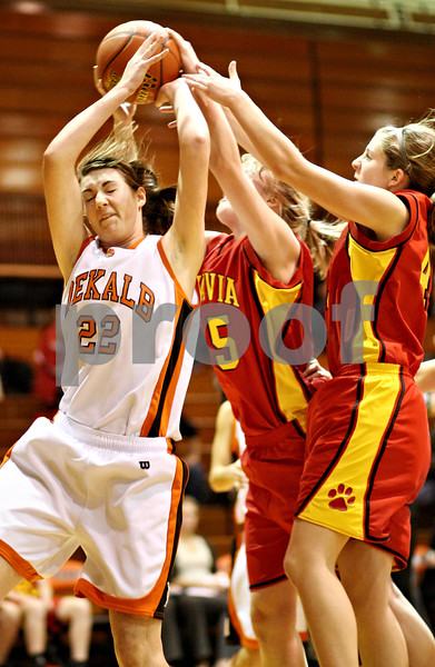 Beck Diefenbach  -  bdiefenbach@daily-chronicle.com<br /> <br /> DeKalb's Emily Bemis (22, left) fights for a rebound during the first quarter of the game against Batavia at DeKalb High School in DeKalb, Ill., on Tuesday Dec. 8, 2009.