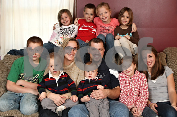 Beck Diefenbach  -  bdiefenbach@daily-chronicle.com<br /> <br /> The Bubolz family. (Top row from left) Anika, 6, Simon, 8, Salome, 8, and Avery, 6. (Bottom row from left) Sterling, 13, Tra, 2, Nicole, Thad, 2, Ross, Micah, 10 and Kennedy, 15.