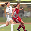 Beck Diefenbach  -  bdiefenbach@daily-chronicle.com<br /> <br /> Sycamore's Karissa Miller (left) fouls Cathum Glenwood's Eryn Sullivan (right) during the first half of the Class 2A third place tournament game at North Central College in Naperville, Ill., on Saturday June 6, 2009. Sycamore lost 1 to 2, taking fourth place in the tournament.