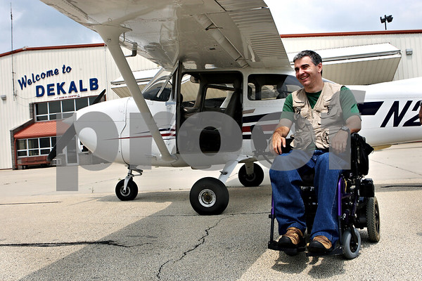 Rob Winner – rwinner@daily-chronicle.com<br /> Gasper Gomez Cozar, a 37-year-old paraplegic, took his first solo flight in a cessna at the DeKalb Taylor Municipal Airport on Wednesday afternoon.<br /> 07/22/2009