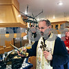 Beck Diefenbach  -  bdiefenbach@daily-chronicle.com<br /> <br /> Center, Father Chris Webb blesses the kitchen with holy water during the house blessing ceremony at the Orthodox Christian Fellowship House in DeKalb, Ill., on Wednesday Jan 28, 2009.
