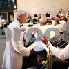 Beck Diefenbach  -  bdiefenbach@daily-chronicle.com<br /> <br /> Dee Palmer, left, talks with principle trombone player Kirk Lundbeck before the start of the DeKalb Municipal Band performance in Hopkins Park on Tuesday July 21, 2009.