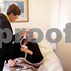 Beck Diefenbach  -  bdiefenbach@daily-chronicle.com<br /> <br /> Bev Willrett wipes the face of her husband Jim an ALS patient, at their home in Malta, Ill., on Thursday Oct. 16, 2009.