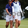 Beck Diefenbach  -  bdiefenbach@daily-chronicle.com<br /> <br /> USA's Christina Kim, left, embraces Michelle Wie as they walk down the 7th hole against team Europe at the Solheim Cup in Sugar Grove, Ill., on Saturday Aug. 22, 2009.