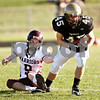 Beck Diefenbach  -  bdiefenbach@daily-chronicle.com<br /> <br /> Sycamore running back David Lord (45) shakes off Wheaton Academy defensive back Brian Macdonald (9) completes a pass for a touchdown during the third quarter of the game at Sycamore High School in Sycamore, Ill., on Saturday Nov. 7, 2009. Sycamore defeated Wheaton Academy 42 to 0.