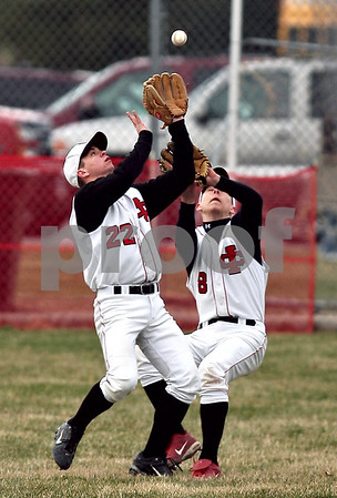 Beck Diefenbach  -  bdiefenbach@daily-chronicle.com<br /> <br /> Indian Creek's Ryan Fox, left, (22) and Steven Voris (8) nearly collide to catch a pop fly during the top of the second inning of the game against Amboy High School at Indian Creek High School in Shabbona, Ill., on Friday March 27, 2009. Fox made the catch.