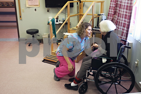 Beck Diefenbach  -  bdiefenbach@daily-chronicle.com<br /> <br /> Physical Therapist Joanne Mata chats with resident Sonja Farrand during a physical therapy session at Bethany Health Care and Rehabilitation Center in DeKalb, Ill., on Thursday Jan. 15, 2008.
