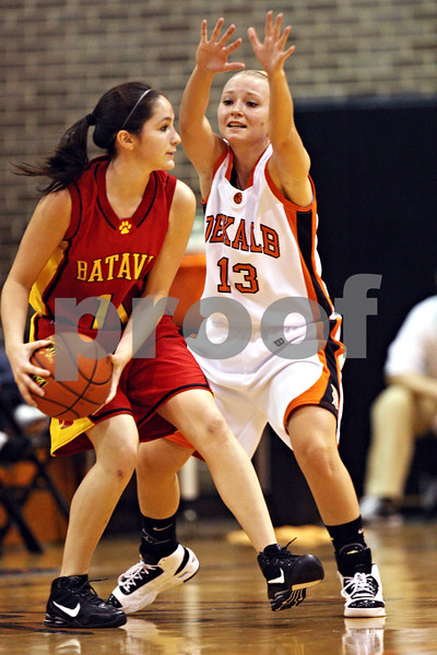 Beck Diefenbach  -  bdiefenbach@daily-chronicle.com<br /> <br /> DeKalb's Kay Smith (13, right) guards Batavia's Sami Villareal (11) during the second quarter of the game at DeKalb High School in DeKalb, Ill., on Tuesday Dec. 8, 2009.