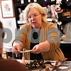 Beck Diefenbach  -  bdiefenbach@daily-chronicle.com<br /> <br /> Marcia Elliott, owner of Made Just for You, gives change to a customer at her shop in Sycamore, Ill., on Tuesday Nov. 3, 2009.