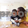 Beck Diefenbach  -  bdiefenbach@daily-chronicle.com<br /> <br /> Dana Moore kisses her son J.J., 3, while he has a snack at Hope Haven in DeKalb, Ill., on Saturday Nov. 21, 2009. Moore and her children, who have been living at Hope Haven, hope to move into a new home in January.