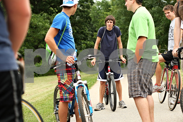 Beck Diefenbach  -  bdiefenbach@daily-chronicle.com<br /> <br /> Behind North Elementary School, Aaron Pasch, of Sycamore, discusses with his group of cyclist friends about where to go during their ride in Sycamore, Ill., on Tuesday July 14, 2009