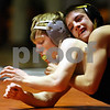Beck Diefenbach  -  bdiefenbach@daily-chronicle.com<br /> <br /> DeKalb's James Waters is temporarily subdued by Sycamore's Austin Zimmer during the 112 weight class match at DeKalb High School in DeKalb, Ill., on Thursday Jan. 22, 2009.