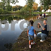 Beck Diefenbach  -  bdiefenbach@daily-chronicle.com<br /> <br /> Right, Donny Jolly, 29, teaches local kids how to fish in the retention pond in Evergreen Village Mobile Home just east of Sycamore, Ill., on Thursday Sept. 3, 2009. Jolly planned on returning the fish they caught back to the pond.