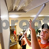 Beck Diefenbach  -  bdiefenbach@daily-chronicle.com<br /> <br /> Tyler Pumfery installs new energy efficient bulbs for his mother's hair salon Unique Concepts in Sycamore, Ill., on Tuesday June 23, 2009. Owner Patty Pumfrey will have the first salon in northern Illinois to be certified as green.