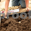 Beck Diefenbach  -  bdiefenbach@daily-chronicle.com<br /> <br /> Josh Worley, 14, places potato spuds into newly tilled ground at the Erehwon Farm in Elburn, Ill., on Wednesday June 3, 2009.