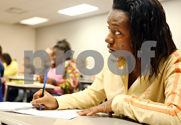 Beck Diefenbach  -  bdiefenbach@daily-chronicle.com<br /> <br /> Brenda Jones, 22 of Chicago, takes notes during the class Survey of American Music at Kishwuakee College in Malta, Ill., on Friday Aug. 28, 2009.