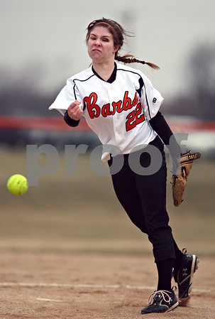 Beck Diefenbach  -  bdiefenbach@daily-chronicle.com<br /> <br /> DeKalb pitcher Lisa Oller throws the ball during the top of the fourth inning of the first game in a double header against Elgin High School at DeKalb High School in DeKalb, Ill., on Monday March 23, 2009.
