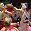 Beck Diefenbach  -  bdiefenbach@daily-chronicle.com<br /> <br /> Northern Illinois forward Becky Smith (34) reaches for a rebound recovered by Ball State forward Emily Maggert (41) during the first half of the game at the NIU Convocation Center in DeKalb, Ill., on Wednesday Jan. 21, 2009.