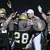 Rob Winner – rwinner@daily-chronicle.com<br /> <br /> Joe Dougherty (28) celebrates after Sycamore scores their first touchdown in the second quarter after a run by quarterback Trevor Mathey (12).<br /> <br /> 10/23/2009
