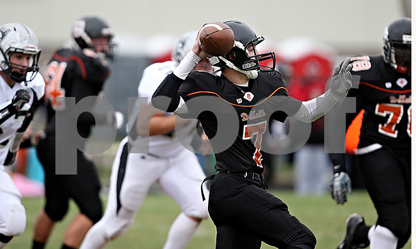 Rob Winner - rwinner@daily-chronicle.com<br /> <br /> Quarterback Dylan Donnelly throws for a touchdown giving DeKalb an early lead.<br /> <br /> 10/10/2009