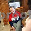 Beck Diefenbach  -  bdiefenbach@daily-chronicle.com<br /> <br /> Connie Dailey receives her meal from Assistant Meals on Wheels Coordinator Colleen Bredeson on her route on Monday May 18, 2009. Daily receives four meals a week from the program.