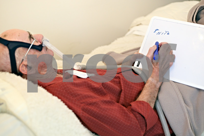"""Beck Diefenbach  -  bdiefenbach@daily-chronicle.com<br /> <br /> Unable to speak, Jim Willrett, an ALS patient, writes on his white board """"nite"""" referring to when he feels pain in his foot  during a visit from a nurse from DeKalb County Hospice at his home in Malta, Ill., on Thursday Oct. 16, 2009."""