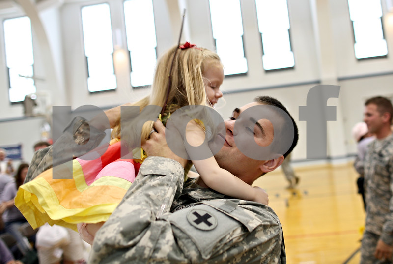 Beck Diefenbach  -  bdiefenbach@daily-chronicle.com<br /> <br /> Sebastian Wolff, of Rockford, lifts his daughter Grace, 3, after returning from a tour in Afghanistan at the Sycamore National Guard Armory in Sycamore, Ill., on Monday June 1, 2009.